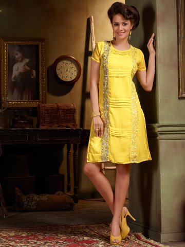 https://static.cilory.com/146882-thickbox_default/cockqtail-yellow-regular-wear-kurti.jpg