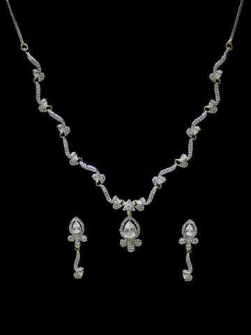 https://d38jde2cfwaolo.cloudfront.net/67618-thickbox_default/american-dimaond-necklace-set-with-earrings.jpg
